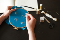 Workplace of an embroiderer with couture embroidery on a hoop