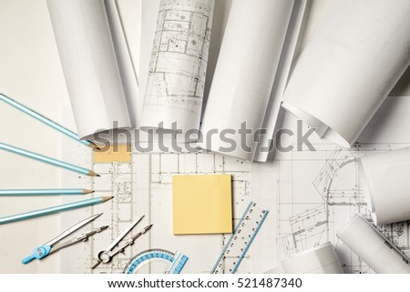 Workplace of architect - Architect rolls and plans.architectural plan,technical project drawing. Engineering tools view from the top. Construction background. #521487340