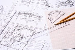 Workplace of architect. Architectural design, sketch, drawing paper, drawings, simple pencil, transparent ruler with protractor on the table