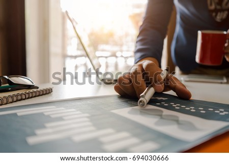 Workplace of businesses,Businessman working new project in home office,,laptop computer and coffee cup and notepad Blurred Background. - Shutterstock ID 694030666