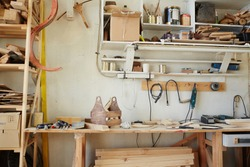 Workplace of modern craftsman in artisan workroom with all necessary equipment