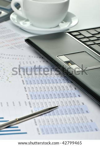 Workplace of the businessman. Laptop in an environment of financial calculations