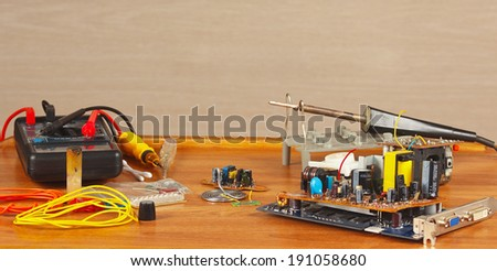 Workplace, tools and electronics parts master closeup