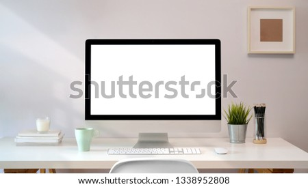 Workplace with blank screen pc comfortable work table. Loft desk space  #1338952808