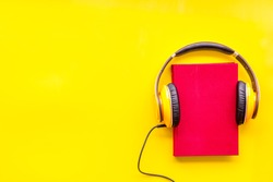 workplace with books and headphones on yellow background flatlay mockup