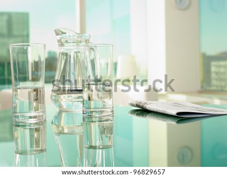 Workplace with glassware and newspaper