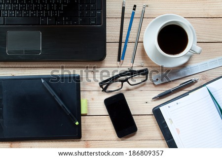 workplace with notebook  pen...