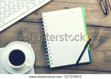 Workplace with notepad,coffee and keyboard