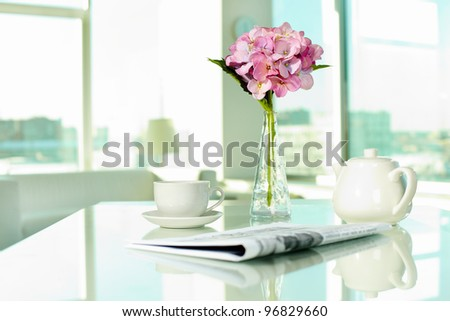 Workplace with porcelain cup and pot, newspaper and bunch of flowers #96829660