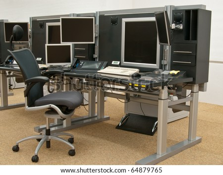 Workplace with set of monitors for surveillance