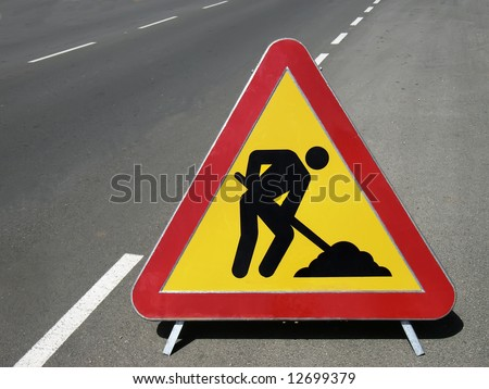 Works ahead warning sign on a road - stock photo