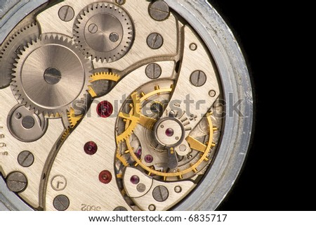 Works of pocket watch over black