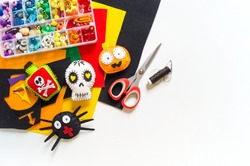 Workshop halloween decor felt toy. Spider Bat Black Cat Devil Skull Skeleton on a white background. Material for creativity and sewing. Holiday halloween.