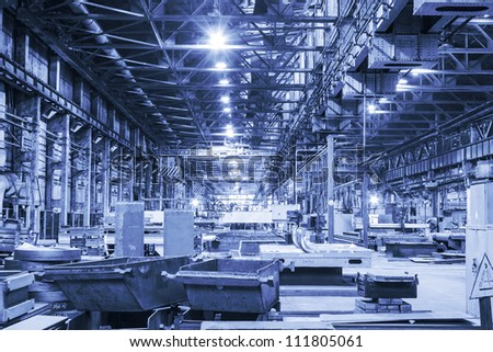 Workshop of machinery plant in blue