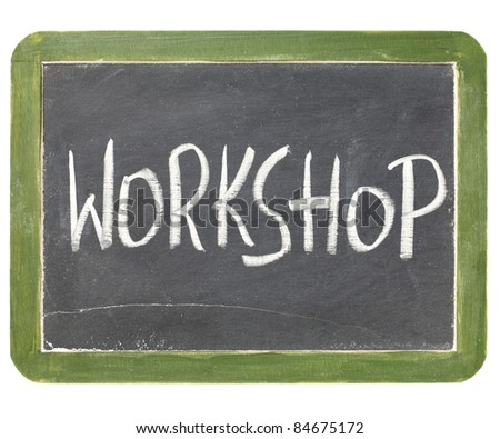 workshop word in white chalk handwriting on a vintage slate blackboard, isolated on white