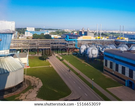 workshops of a chemical plant. Chemical plant for the production of ammonia and nitrogen fertilizers. Ion for the daytime. The pipeline connecting the factory floor. boiler room, power supply