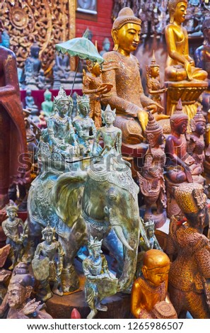 Workshops of Shwe-gui-do quarter are best place to enjoy traditional crafts, watch stunning wooden and bronze sculptures, depicting Buddha, Nat deities, Royal Family and animals, Mandalay, Myanmar. #1265986507
