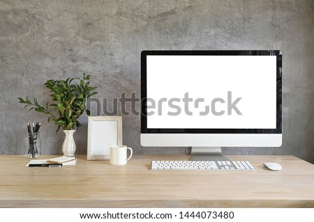 Workspace computer mockup and photo frame, coffee with plant decoration on wood table and loft wall. #1444073480