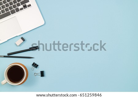 Workspace home office blue background with notebook, coffee, clips and accessories. Top view with copy space, flat lay. #651259846