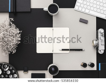 Workspace of photographer. Photographer's table with tablet , vintage camera, coffee and keyboard in black and grey.Creative workspace. Ideas and inspiration. Flat lay.