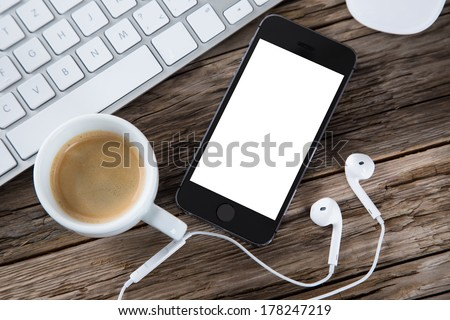 Workspace with coffee cup, tablet pc and note paper on old wooden table