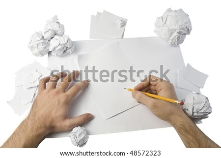 Workspace with crushed paper and hands. Isolated