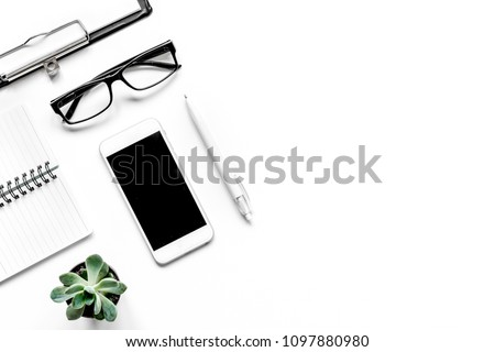 Workspace with glasses and notebook office desk white background #1097880980