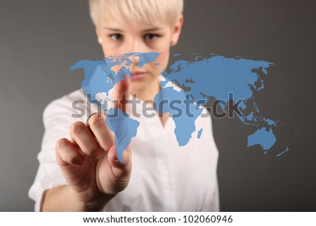 World business connection concept - business woman touching screen