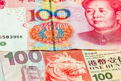 World business economy concept : 100 China Yuan and Hong Kong HKD banknote use as economic of Asian country issue
