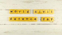 World Civil Defence Day.words from wooden cubes with letters photo