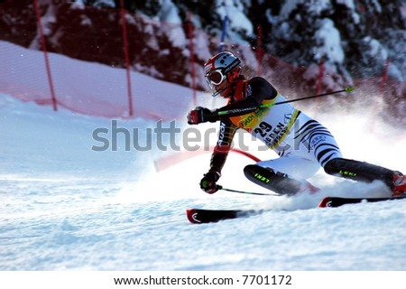 world cup female slalom racer knocking down gate - stock photo