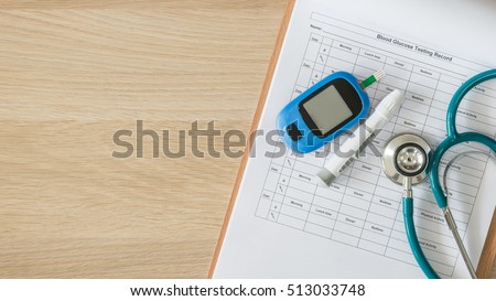 World diabetes day, National American diabetic awareness month concept with blood drop examination tool kit on background