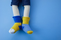 World Down syndrome day background. Down syndrome awareness concept. Toy legs with different socks as symbol of down syndrome.