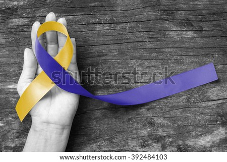 World down syndrome day WDSD March 21 Blue yellow awareness ribbon on helping hand for raising support on patient with down syndrome illness disability and Thoracic Outlet Syndrome - (TOS) #392484103