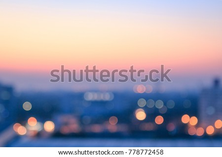 World environment day concept: Bokeh light and blur city skyline autumn sunrise background