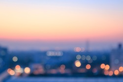 World environment day concept: Bokeh light and blur modern city skyline sunrise background. Bangkok, Thailand, Asia