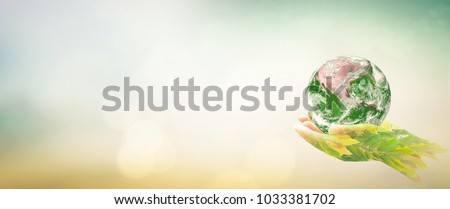 World environment day concept: Double exposure hands of tree and earth global on blurred nature background. Elements of this image furnished by NASA #1033381702