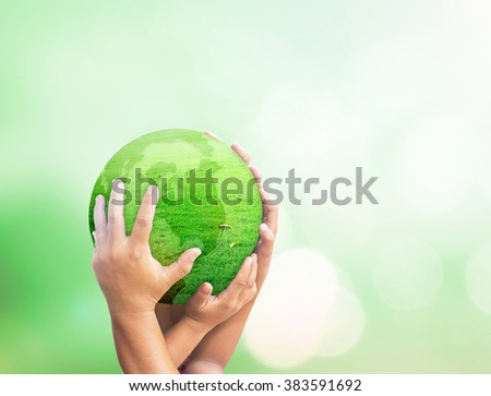 World environment day concept: Many people hands holding earth globe of grass over blurred green nature background