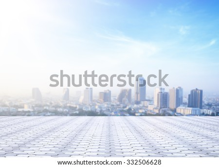 World environment day concept: Stone terrace at rooftop with abstract blur Bangkok city and blue sky background