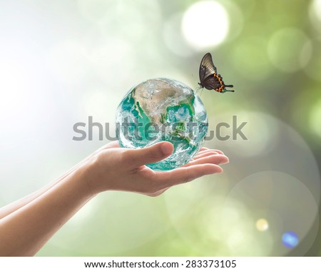 World environment day concept with green planet in clean biological nature in volunteer's hand support. Element of  image furnished by NASA    #283373105