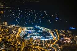 World Fair MYS Monaco Yacht Show at night, Port Hercules, luxury megayachts, many shuttles, party time, boat traffic, long exposure, aerial view, cityscape, it is a lot of yachts in the sea