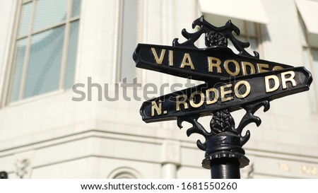 World famous Rodeo Drive symbol, Cross Street Sign, Intersection in Beverly Hills. Touristic Los Angeles, California, USA. Rich wealthy life consumerism, Luxury brands and high-class stores concept Stockfoto ©