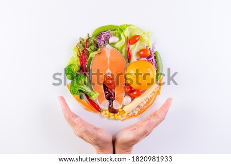 World food day. Top view of Salmon, fresh vegetables, fruit, herbs and spices on white paper background.