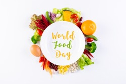 World food day, vegetarian day, Vegan day concept. Top view of fresh vegetables, fruit, with text in plate on white paper background.