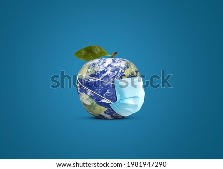 World Food Safety Day concept. Apple world wear mask symbol of food safety. Covid-19 Health food safety concept. World Food Day concept.