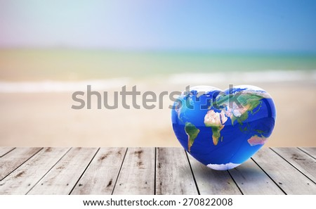 World glass ball in Heart shape on old wood and on beach background .Earth day concept.Elements of this image furnished by NASA #270822008