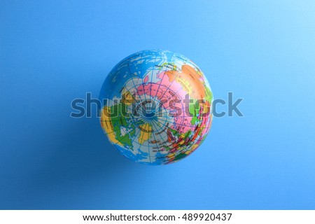 world globe ball on blue paper background