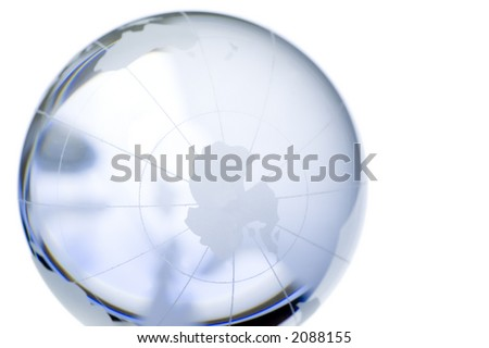 World globe: continents over transparent glass, isolated on white. South Pole. More in my portfolio