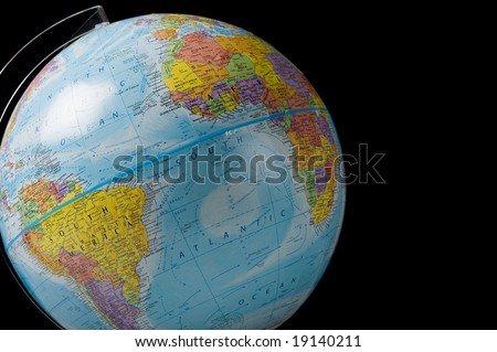 World globe on a black background with copy space