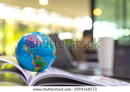 World globe on text book. Graduate study abroad programs.     International education school Concept.